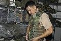 US Navy 041231-N-3207B-037 Chief Hospital Corpsman Alberto Redublo of Naval Environmental and Preventive Medicine Unit Six (NEPMU-6) inspects equipment he will need for deployment to Indonesia.jpg