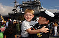 US Navy 050301-N-7615S-126 Navy Counselor 1st class Althea Komorowski reunites with her son in San Diego, Calif., following a deployment to the Western Pacific Ocean.jpg