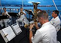 US Navy 050327-N-3019M-003 Members of the Pacific Fleet Band perform a hymn at the Easter Sunrise Service aboard the battleship USS Missouri (BB 63).jpg