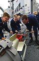US Navy 050418-N-5526M-012 Sailors working in the sonar shop aboard guided missile destroyer USS Mustin (DDG 89) load a MK-46 Mod 5A(SW) torpedo.jpg