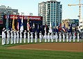 US Navy 050420-N-7878F-062 U.S. Navy Sailors stand at attention and salute while the National Anthem is sung during Military Appreciation Day at Petco Park, home to the San Diego Padres.jpg
