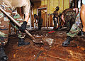 US Navy 050912-N-4374S-005 U.S. Navy Seabees, assigned to Naval Mobile Construction Battalion One Three Three (NMCB-133), tear through a plywood floor as they take part in restoring Hope Haven.jpg