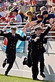 US Navy 051105-N-9693M-006 U.S. Naval Academy Midshipmen race across the end zone fence celebrating one of four first quarter touchdowns against Tulane.jpg