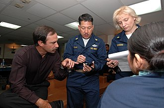 Telemedicine - U.S. Navy medical staff being trained in the use of handheld telemedical devices (2006).
