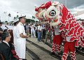 US Navy 060906-N-0879R-004 Commander, Navy Region Hawaii, Rear Adm. T. G. Alexander prepares to make an offering during a Lion Dance following the arrival of two ships representing China's Navy.jpg