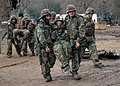 US Navy 061203-N-3560G-014 Members of Naval Mobile Construction Battalion Four (NMCB-4) transport wounded to the Battle Aid Station (BAS) during a mass casualty drill at the field exercise Operation Bearing Duel.jpg