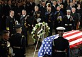 US Navy 061230-D-1142M-015 Chief of Naval Operations (CNO) Adm. Mike Mullen, far-left, accompanied by other senior military leaders, pay their respects at the conclusion of memorial services for Gerald R. Ford.jpg