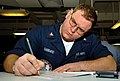 US Navy 070301-N-7780S-004 Aviation Electronics Technician 2nd Class John Gabbard focuses on completing his advancement examination for first class petty officer on the mess decks aboard Nimitz-class USS John C. Stennis (CVN 74.jpg