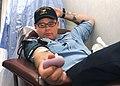 US Navy 070403-N-2259V-003 A Sailor watches while he donates blood aboard the amphibious assault ship USS Tarawa (LHA 1).jpg