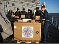 US Navy 070429-N-5074X-017 Sailors assigned to the guided missile destroyer USS Mitscher (DDG 57) load pallets of toys for Project Handclasp in Montevideo.jpg