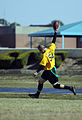 US Navy 071201-N-5328N-585 Information Systems Technician First Class Joseph Caldwell holds a football high as he makes the first touchdown for Navy during the fifth annual CID Corry Station Flag Football Game at Corry Station.jpg