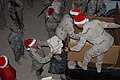 US Navy 071214-N-6794Z-001 Master Chief Cryptologic Technician (Technical) Dale K. Arnold, command master chief, U.S. 5th Fleet distributes holiday gift boxes to Sailors deployed to Camp Victory, Iraq.jpg