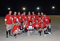 US Navy 071230-N-3768T-026 The softball team the Nicks Styx made up of Seabees attached to Naval Mobile Construction Battalion (NMCB) 40, holds the Championship trophy after winning the Jingle Bell Softball Bash.jpg