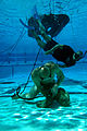 US Navy 080805-N-6552M-048 A Basic Crewman Training (BCT) student demonstrates underwater knot tying skills during water proficiency training at Naval Amphibious Base Coronado.jpg