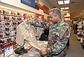 US Navy 081201-N-2468S-003 Ship's Serviceman 2nd Class Charles Clay shops for the new service uniform at the Navy Exchange.jpg