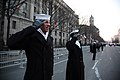 US Navy 090120-N-5386H-553 Sailors forming part of the honor cordon salute a military color guard as it passes by on Pennsylvania Avenue during the 2009 Inaugural Parade.jpg