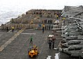 US Navy 090504-N-8283S-021 INDIAN OCEAN (May 4, 2009) Sailors and Marines perform a foreign object debris (FOD) walk down after an all-hands call aboard the amphibious assault ship USS Boxer (LHD 4).jpg