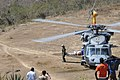 US Navy 100212-N-4995K-051 Lt. Cmdr. Matthew McLean helps carry a Haitian patient from an MH-60S Sea Hawk helicopter.jpg
