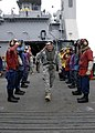 US Navy 100304-N-7638K-101 Lt. Gen. Ken Keen, commander of Joint Task Force Haiti, is piped ashore as he departs the amphibious dock landing ship USS Fort McHenry (LSD 43).jpg