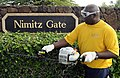 US Navy 100309-N-7498L-003 Chief Boatswain's Mate James Hypolite, assigned to the 1st Lt. Division at Joint Base Pearl Harbor-Hickam, trims the hedges at the Nimitz Gate during the installation-wide base cleanup.jpg