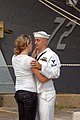US Navy 100708-N-5292M-647 Fire Controlman 2nd Class Kevin Cunningham, assigned to the guided-missile cruiser USS Vella Gulf (CG 72), says good-bye to his wife at Naval Station Norfolk.jpg