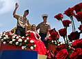 US Navy 100721-N-1722W-192 The village of Piti's Royal Princess RayAna Lujan Rojas, escorted by a Sailor and a Marine, waves as they ride the float during the 66th annual Liberation Day celebration parade.jpg