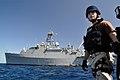 US Navy 110218-N-7293M-037 Electronics Technician 2nd Class Jose Lopez-Davila rides an 11-meter rigid-hull inflatable boat from the amphibious tran.jpg