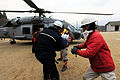 US Navy 110315-N-5503T-461 Japanese citizens move food and water out of an HH-60H Sea Hawk helicopter assigned to the Black Knights of Helicopter A.jpg