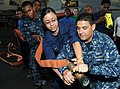 US Navy 110617-N-QL471-080 Chief Aviation Electrician's Mate Daniel Lucero, right, and Aviation Boatswain's Mate (Handling) Airman Destiny Phillips.jpg