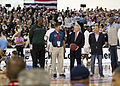 US Navy 111111-N-AC887-005 Secretary of the Navy (SECNAV) the Honorable Ray Mabus stood center court with a wounded warrior, left, Earvin.jpg