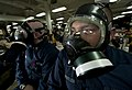 US Navy 111212-N-DR144-251 Machinist's Mate 2nd Class Joshua Beutler listens to training while wearing his MCU-2P protective mask.jpg