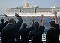 US Navy 120124-N-ZF681-268 Sailors aboard the guided-missile destroyer USS Halsey (DDG 97) wave at the cruise ship Arcadia as it passes.jpg