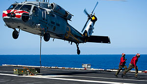 US Navy 120212-N-OY799-676 Sailors clear the area for an MH-60S Sea Hawk helicopter.jpg