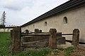 Uherce Mineralne, mur obronny wokół cmentarza z bramkami przy kościele par. p.w. Św. Stanisława Biskupa, A-173.jpg