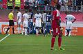 Valais Cup 2013 - OM-FC Porto 13-07-2013 - Rassemblement autour de Fucile et Jérémy Morel avant l'expulsion du deuxième.jpg
