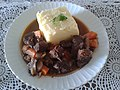 Veal stew with a block of potato puree.jpg