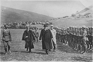 National Schism - Venizelos reviews a section of the Greek army on the Macedonian front during the First World War, 1918. He is accompanied by Admiral Pavlos Kountouriotis (left) and General Maurice Sarrail (right).