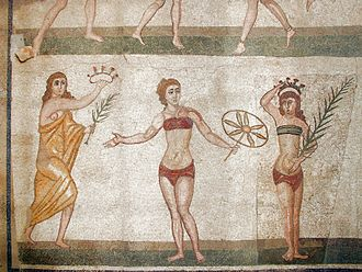 Clothing in ancient Greece - Detail of a mosaic from the Villa Romana del Casale, Sicily, featuring a woman in a strophion.