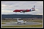 Virgin Blue E170 over RAAF A32-346-1 (5513917986).jpg