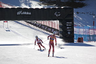 Two female skiers in competition uniform