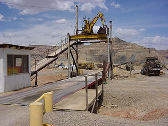 Truck scale - A weighbridge at a gravel pit. The weighbridge is the two part platform over which trucks are driven. The upper works is auxiliary equipment for leveling the load in the truck and is not part of the scale. This scale uses electronic measuring equipment