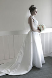 A Bride In Contemporary White Wedding Dress With Train Tiara And Veil Taken 2003
