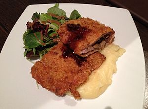Wiener Schnitzel - Pork schnitzel variation stuffed with fried mushrooms and onions (Fuhrmann Schnitzel vom Schwein), served with mashed potato and side salad