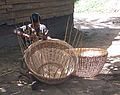 Woman weaving baskets near Lake Ossa.jpg