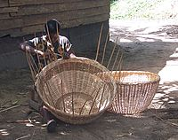 A woman weaves a basket in Cameroon.