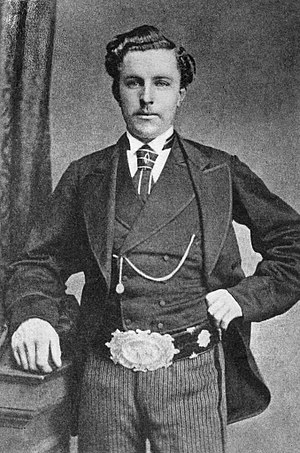 Championship belt - Tom Morris, Jr. wearing the Championship Belt.