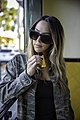Young attarctive woman vaping ecigarette.jpg