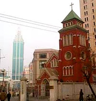 Yuguang Street Church - Yuguang Street Church (Dalian, China), with Zhongshan Square and Dalian World Trade Center Bldg. in the Background