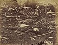 """A Sharpshooter's Last Sleep."" Compare the two photos of a Confederate killed at Gettysburg. Why might the photographer Alexander Gardner and his team move the body? LOC 9160159658.jpg"