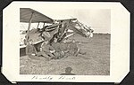 """Badly Bent""- photograph of five men in uniform sitting in front of a crashed Royal Flying Corps aircraft with a shamrock symbol on the side. (7980825403).jpg"